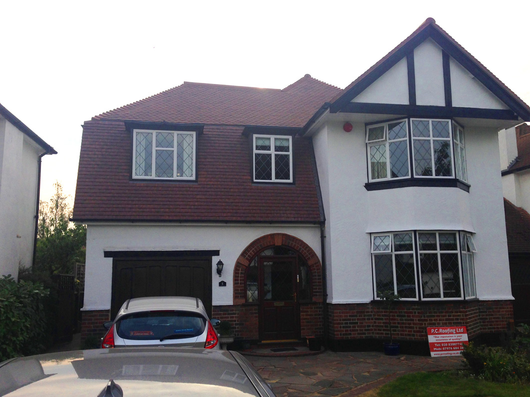 Clay tile roof petts wood pc roofing for Clay roofs