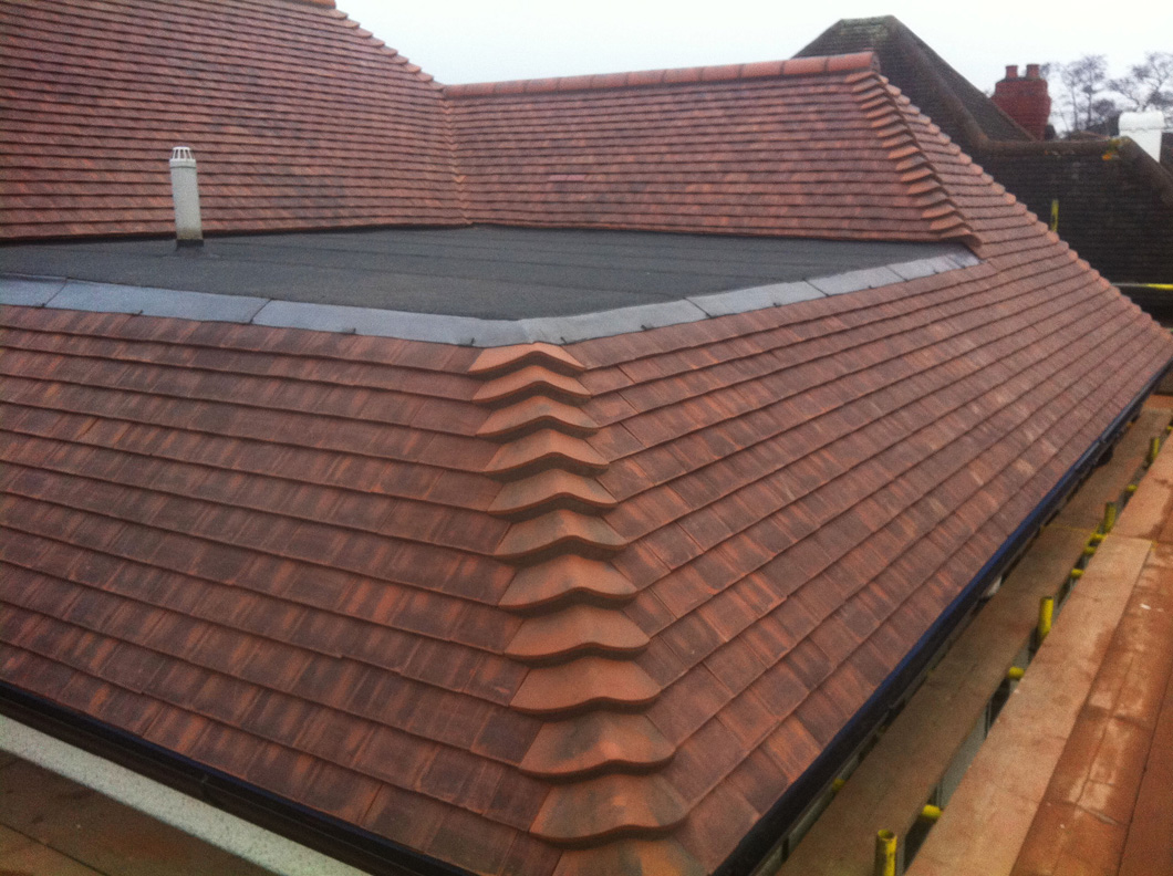 Clay tile roof petts wood pc roofing for Clay tile roofs